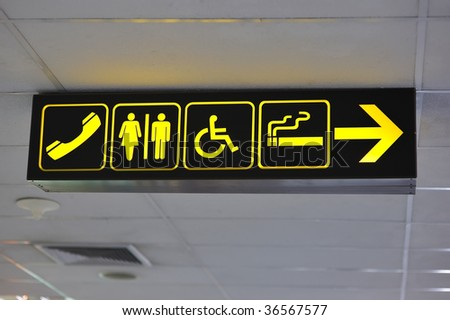 Airport toilet signs, yellow on black