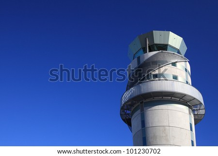 Airport tower at Christchurch airport in New Zealand against blue sky. - stock photo