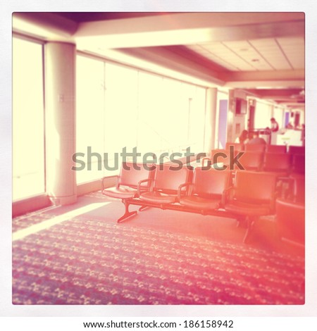 Airport waiting area with lighting effect - stock photo