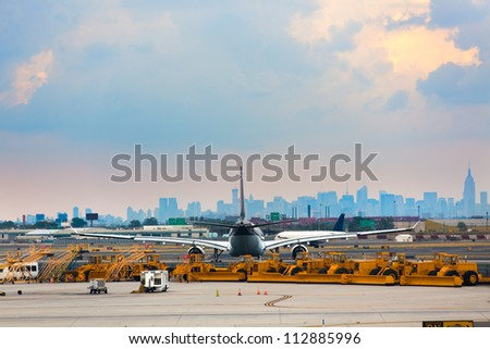 Airports runway and ground services waiting to service. With an airplane in-front of city. - stock photo