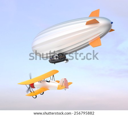 Airship and yellow biplane flying in the blue sky - stock photo