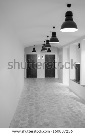 aisle to the elevator (black and white) - stock photo