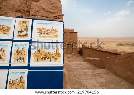AIT BEN HADDOU, MOROCCO, AUGUST, 31: Drawings of local artist at the fortified city, or ksar, along the former caravan route between the Sahara and Marrakech. UNESCO World Heritage Site. 2014. - stock photo