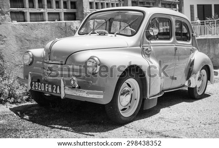 Ajaccio, France - July 6, 2015: Renault 4CV old-timer economy car stands parked on a roadside in French town