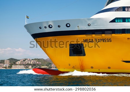 Ajaccio, France - June 30, 2015: The Mega Express ferry, big yellow passenger ship operated by Corsica Ferries Sardinia Ferries shipping company goes on sea. Bow fragment