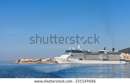 Ajaccio, France - June 30, 2015: White Celebrity Equinox cruise ship moored in Ajaccio, Corsica. It is the second of five Solstice-class vessels, owned and operated by Celebrity Cruises company