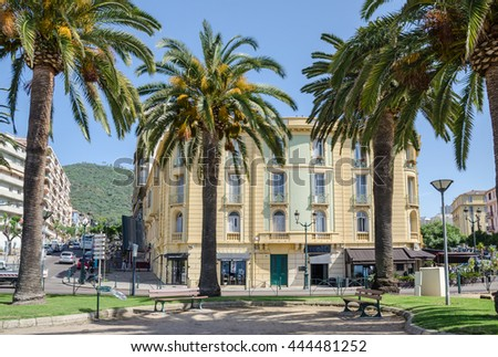 Ajaccio, France - May 27, 2016: View of one of the central streets of capital city of Corsica - Boulevard Albert 1er with palm trees and house number 10.