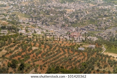 Ajloun town located n Jordan is known by its Castle (Qal'at Ar-Rabad). It was built by one of Saladin's generals in 1184 AD to control the iron mines in the area. Aerial view. - stock photo