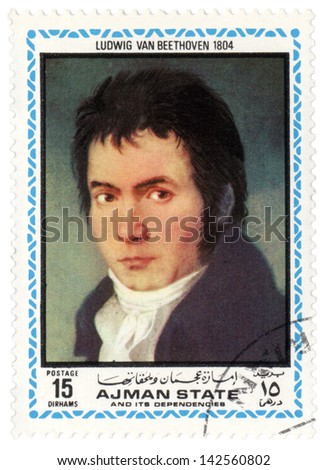 AJMAN - CIRCA 1972: A stamp printed in Ajman shows a portrait of German composer Ludwig van Beethoven in 1804, series, circa 1972 - stock photo