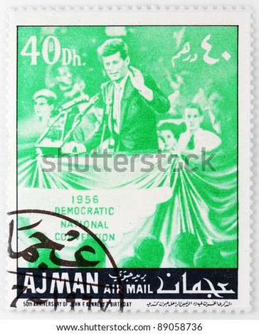 AJMAN - CIRCA 1967: A stamp printed in Ajman shows John F. Kennedy in The National Democratic Convention, circa 1967 - stock photo