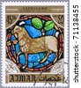 AJMAN - CIRCA 1971: A stamp printed in Ajman shows the horoscope sign of Capricorn, series is devoted to the frescoes in the cathedral of Notre Dame, circa 1971 - stock photo
