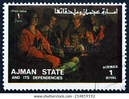 AJMAN - CIRCA 1973: a stamp printed in the Ajman shows Adoration of the Kings, Life of Jesus, circa 1973 - stock photo