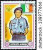 """AJMAN EMIRATE - CIRCA 1971: A stamp printed in United Arab Emirates from the """"13th World Boy Scout Jamboree - Japan"""" issue shows boy scout from Ireland, circa 1971. - stock photo"""