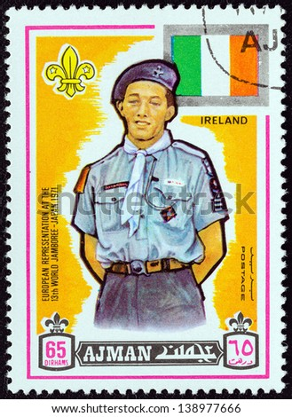"AJMAN EMIRATE - CIRCA 1971: A stamp printed in United Arab Emirates from the ""13th World Boy Scout Jamboree - Japan"" issue shows boy scout from Ireland, circa 1971. - stock photo"
