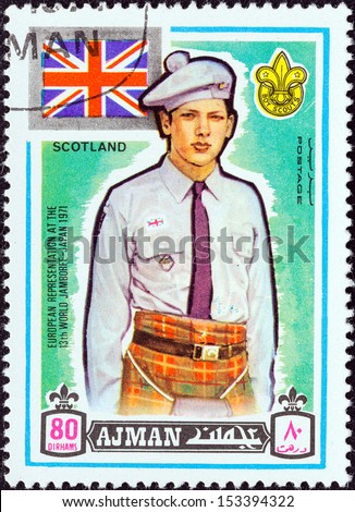 "AJMAN EMIRATE - CIRCA 1971: A stamp printed in United Arab Emirates from the ""13th World Boy Scout Jamboree - Japan"" issue shows boy scout from Scotland, circa 1971.  - stock photo"