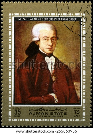 AJMAN STATE - CIRCA 1972: A used postage stamp from Ajman State, depicting a portrait of famous Composer Wolfgang Amadeus Mozart, circa 1972. - stock photo