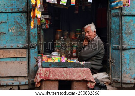 AJMER, INDIA - FEB 04: An unidentified retail shop owner look for customers on February 04,2015 in Ajmer, Rajasthan, India.Small retail shops face big threat from the modern retailers chains in India. - stock photo