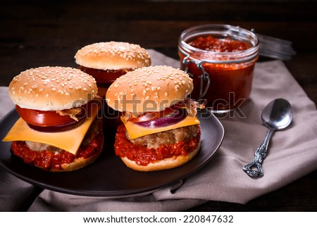 Ajvar beef burger stuffed with cheese and vegetables,selective focus - stock photo