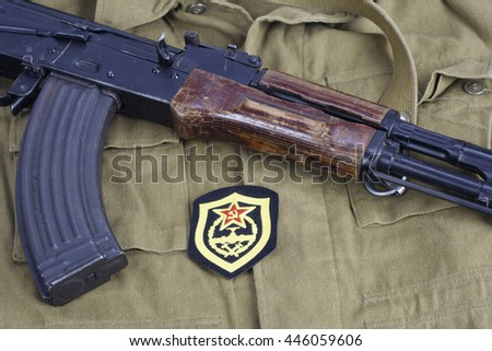 AK47 with Soviet Army Military engineering shoulder patch on khaki uniform background