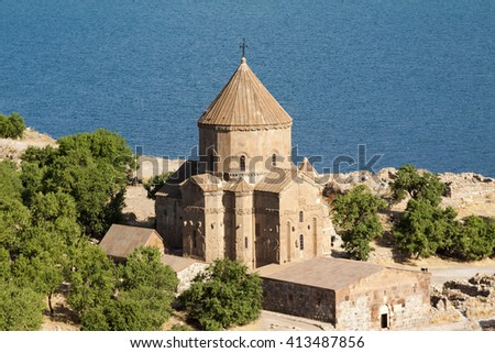 Akdamar Island (Akdamar Adasi) in Van Lake. The Armenian Cathedral of the Holy Cross from 10th century (Akdamar Kilisesi). External walls are decorated with bas-reliefs decipt biblical scenes - stock photo
