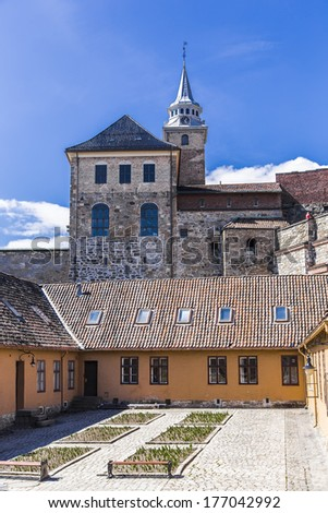 Akershus Castle (Akershus slott) on a rocky promontory in the eastern part of the bay Pipervika - stock photo