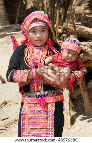 Akha woman with baby