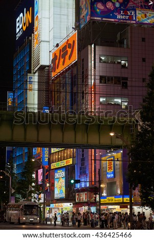 AKIHABARA, TOKYO, JAPAN - AUGUST 2015: Typical busy Akihabara street scene with billboards at night and hundreds of shoppers - Akihabara is Tokyo's electronics, manga and gaming center. - stock photo