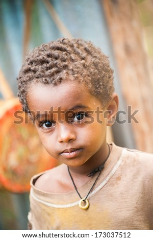 AKSUM, ETHIOPIA - SEP 27, 2011: Portrait of an unidentified Ethiopian cute little boy in Ethiopia, Sep.27, 2011. People in Ethiopia suffer of poverty due to the unstable situation - stock photo