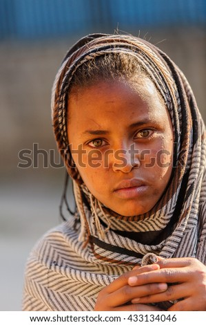AKSUM, ETHIOPIA - SEP 30, 2011: Portrait of an unidentified Ethiopian girl wearing old clothes in Ethiopia, Sep.30, 2011. People in Ethiopia suffer of poverty due to the unstable situation - stock photo