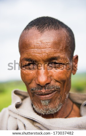 AKSUM, ETHIOPIA - SEP 26, 2011: Portrait of an unidentified Ethiopian old man in Ethiopia, Sep.26, 2011. People in Ethiopia suffer of poverty due to the unstable situation