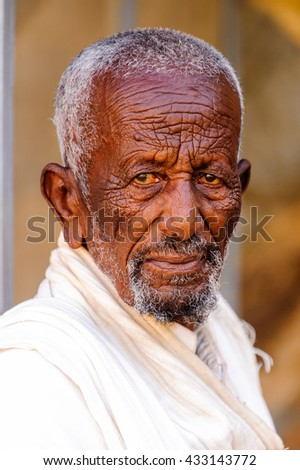 AKSUM, ETHIOPIA - SEP 24, 2011: Unidentified Ethiopian man with white beard in Ethiopia, Sep.24, 2011. Children in Ethiopia suffer of poverty due to the unstable situation - stock photo