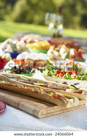 Al Fresco Dining, With Food Laid Out On Table - stock photo