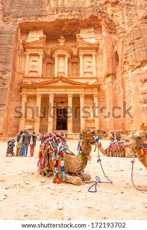 Al Khazneh in the ancient Jordanian city of Petra, Jordan. It is known as the The Treasury. Petra has led to its designation as a UNESCO World Heritage Site. - stock photo