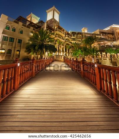 Al Qasr (The Palace) Luxury Hotel in Madinat Al Jumeirah DUBAI with Wooden Bridge  Leading Lines view - stock photo