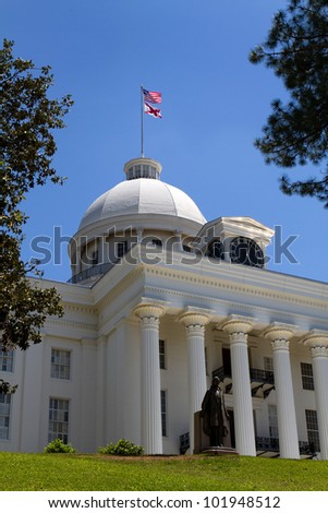 Alabama Statehouse in Montgomery, Alabama, with the statue of Jefferson Davis, President of the Confederacy in front of the entrance. - stock photo