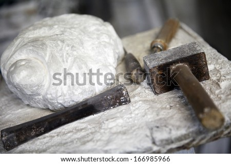 alabaster stone and tools for working stone hammer chisel - stock photo