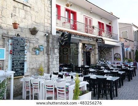 ALACATI,TURKEY-JUNE 07,2016:Alacati is small Aegean town on the western coast of Izmir Province in Turkey,which has been famous for its restaurants in streets, architecture, vineyards and windmills.