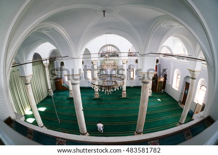 ALACATI,TURKEY-JUNE 07,2016:Pazaryeri Mosque in Alacati Province.After population exchange town was renamed Alacati and church converted to a mosque