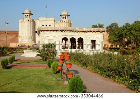 Alamgiri Gate and Hazuri Bagh Pavilion of Lahore Fort in Old City Lahore, Pakistan. Alamgiri Gate, built in 1673 AD is the main entrance to Lahore Fort. Lahore Fort is a UNESCO World Heritage Site. - stock photo
