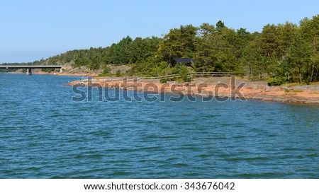 Aland Islands, Finland. Rocky shore bridge between islands