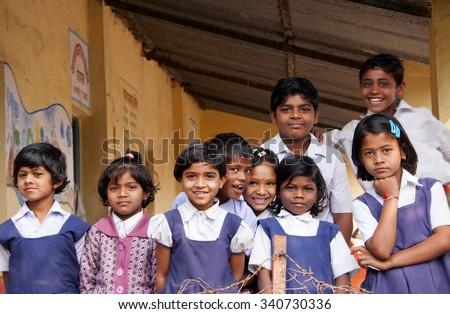 ALANGAON, MAHARASHTRA, INDIA - February 22, 2014: Happy Indian rural boy and girl at their school, Alangaon, Amravati , Maharashtra, India - stock photo
