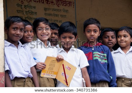 ALANGAON, MAHARASHTRA, INDIA - February 22, 2014: Happy Indian rural boys at their school, Alangaon, Amravati , Maharashtra, India - stock photo