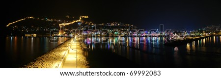 Alanyan port panorama with pier at night - stock photo