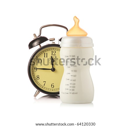 Alarm clock and baby feeding bottle with milk isolated on white background - stock photo