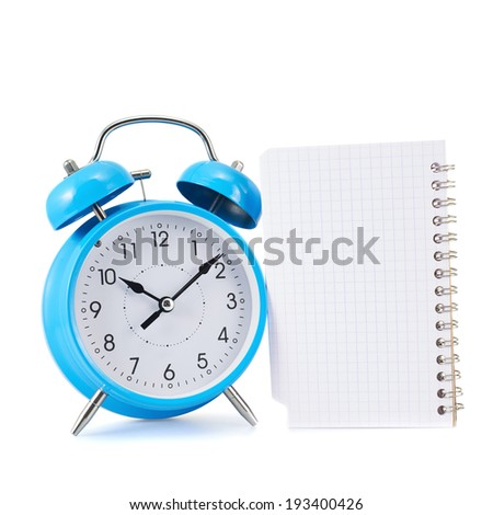 Alarm clock and notebook composition isolated over the white background - stock photo