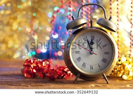 Alarm clock and serpentine - stock photo