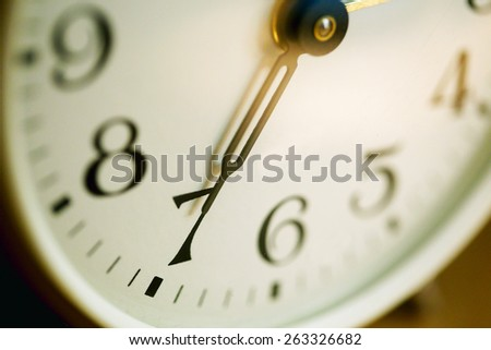 Alarm clock dial on the morning closeup - stock photo