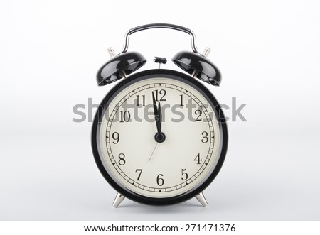 Alarm clock is showing the right time. Midday or midnight. It is about twelve o'clock. - stock photo
