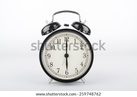 Alarm clock is showing the right time. Six o'clock. - stock photo