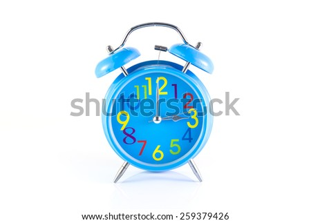 Alarm Clock isolated on white, in blue, showing three o'clock. - stock photo